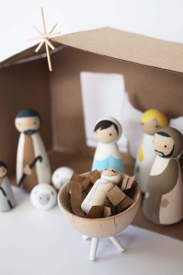 This DIY nativity set with wood peg dolls is budget friendly. If you love modern, this set is for you! Although I think I'd make a different bed for Jesus. The one he's in looks like a grill!