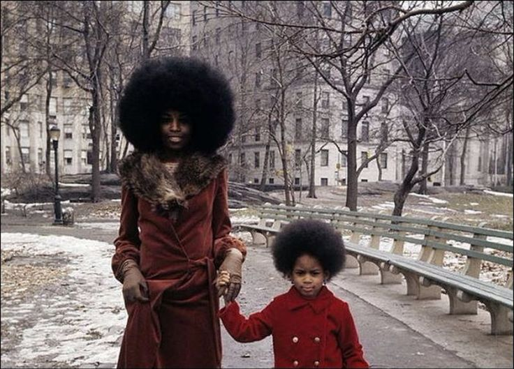 70's style: Mother and daughter taking a walk in New York City, 1970