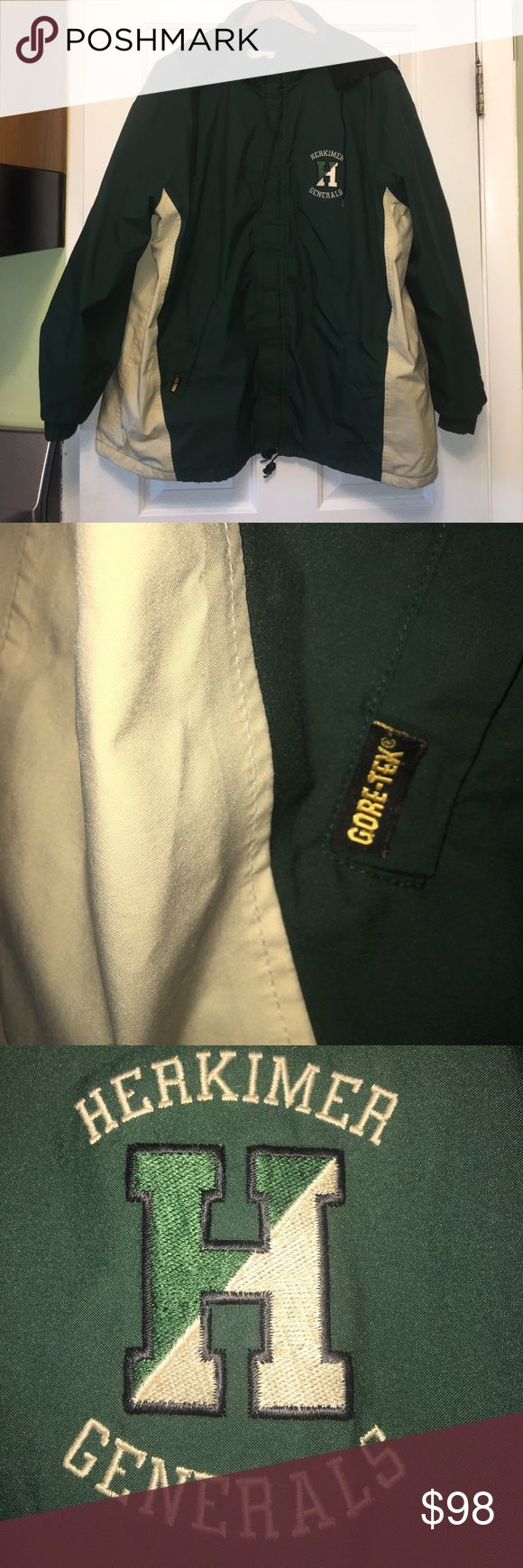 Men's XL Boathouse/Gore-Tex jacket Men's XL forest green & cream Boathouse/Gore-Tex jacket. This is used but in great shape! Has some marks on left side on cream part of jacket but not very noticeable. See pic.  It has the college team my husband coaches at embroidered on the left chest. Which is one of the top men's soccer programs in the country with 10 national championships!  This is a great price for a top of the line rain proof jacket!! Boathouse Jackets & Coats
