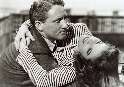 KATHARINE HEPBURN & SPENCER TRACY. One of Hollywood's most famous romances, Hepburn and Tracy met on the set of 1942's Woman of the Year and sparks flew.