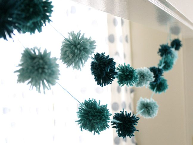Pom Pom Garland DIY. This would be a lovely party decoration or you could do it in Christmas colours for festive decorations.