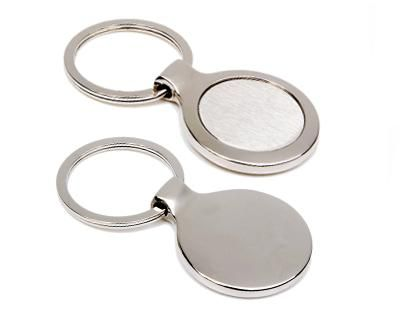 METAL KEY RINGS – K4  Price includes 1 color, 1 position print   2 Color imprint available for an additional charge  Metal keyring with black gift box.  Decoration option: Pad print, Laser engrave Print & Laser Engraving Area: Front 20mm x 10 mm, Rear 30mm x 15 mm