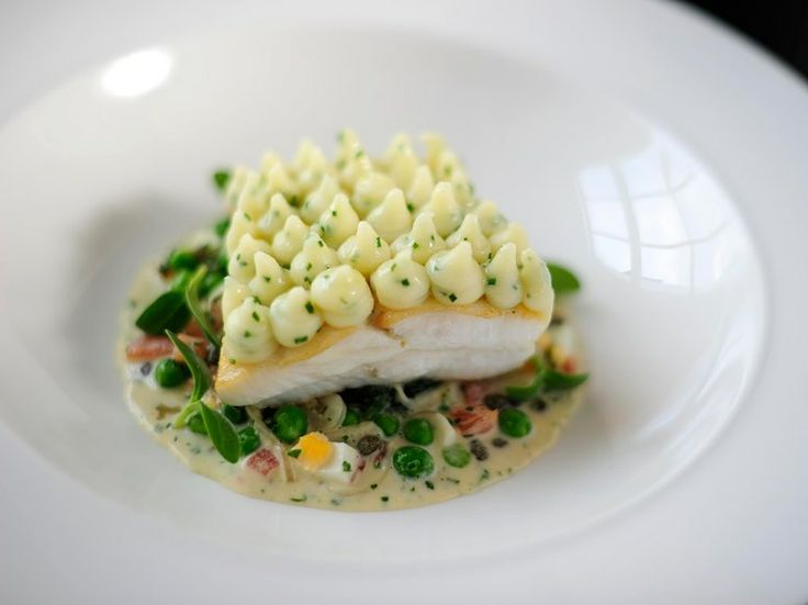 Fish pie using sustainably sourced hake, dressed with parmesan pomme purée and a warm tartare sauce—a main course in the British Airways' Club cabin.
