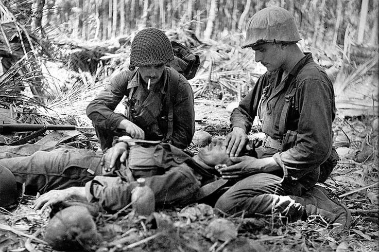 American Soldiers with Injured Australian, New Guinea by  Unknown Artist