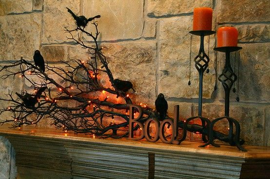 paint a tree branch black & wrapping in orange lights for Halloween