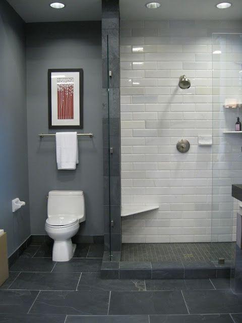dark slate flooring, light shower tile, deep blue grey paint