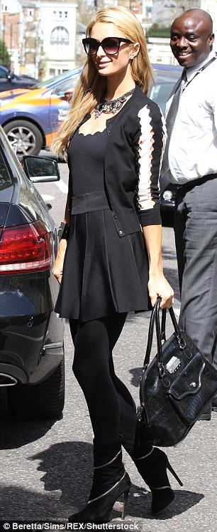 Stunning: Carrying a chic patent bag in her hand, she topped off her look with a pair of d...