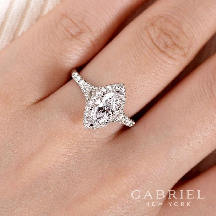 Gabriel NY - Preferred Fine Jewelry and Bridal Brand. 14k White Gold Marquise Halo Engagement Ring. This marquise cut stunner boasts a complementary diamond halo atop an elegant split shank pave diamond band. Even the gallery includes bright diamond accents.  Find your nearest retailer-> https://www.gabrielny.com/storelocator