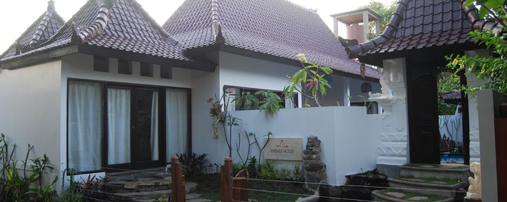 Front view of private villa  Ambary House. in GIli Trawangan, east of Bali. The roof symbolizes sacred mountain. The water and statues are fundamental part of any Balinese gardening,