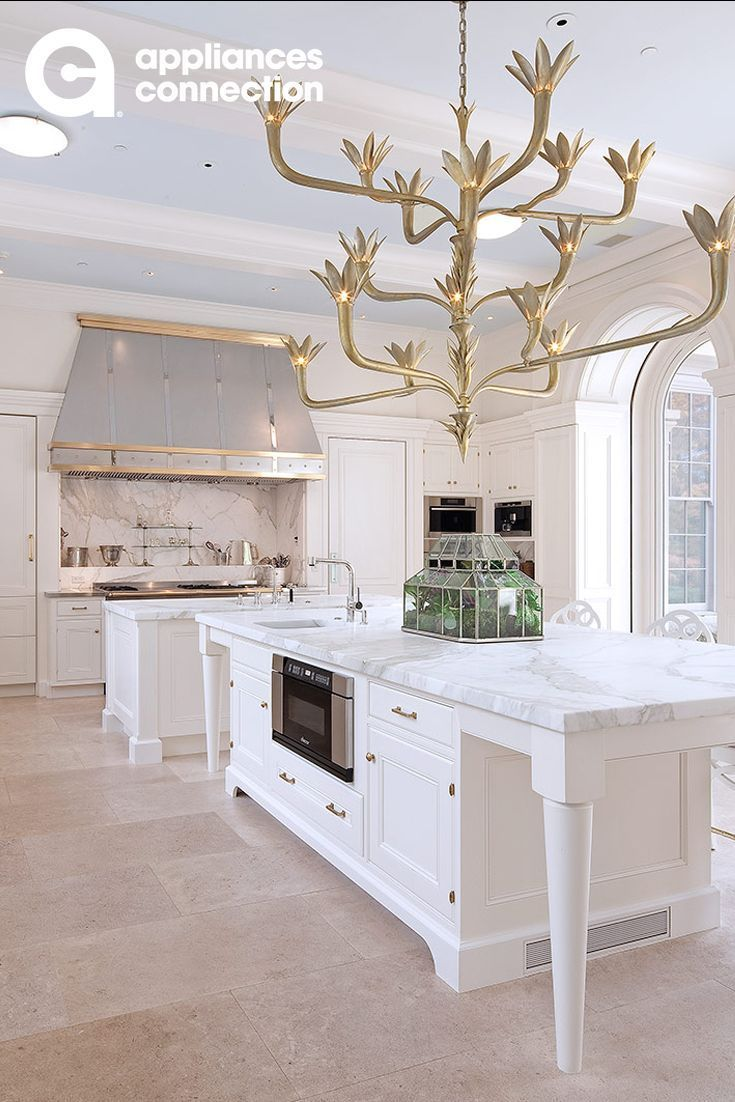 Beautiful White And Gold Kitchen Design Featuring Viking