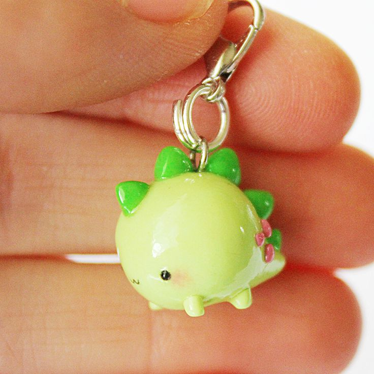 This Chubby Green Dino charm is the perfect accessory to add a touch of cuteness to your life! It is made out of strong oven bake polymer clay. The eyepin (finding) is secured with super glue to ensure durability. It was glazed with a high quality gloss varnish for protection and extra shi...
