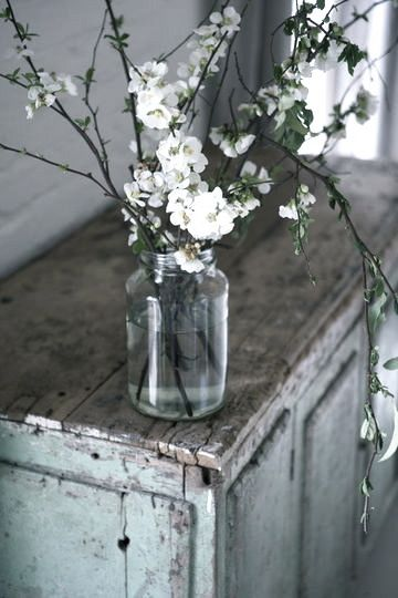 Flowers in a jar on a rustic trunk...♥