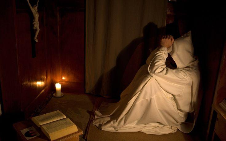 novice at prayer in his cell in the carthusian monastery of serra san bruno :  fernando moleres