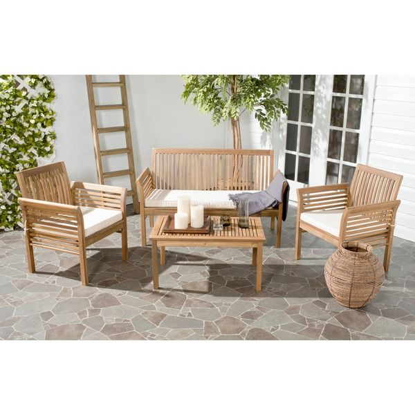 Enjoy your outdoor space in comfort and style with this four-piece outdoor furniture set. Safavieh's Carson teak outdoor furniture set includes two arm chairs, one coffee table and one love seat, whic