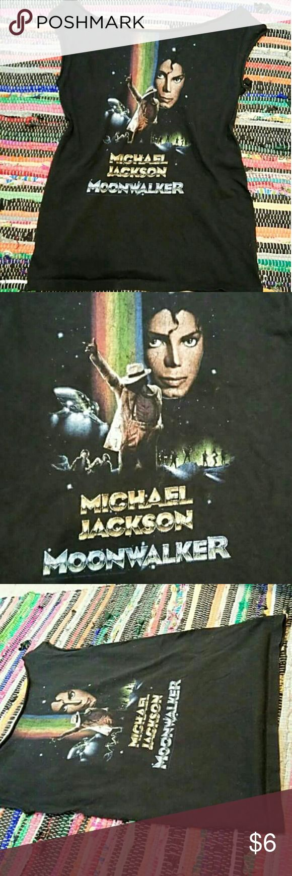 Vintage Michael Jackson Tee This t-shirt is for a Michael Jackson video game that came out in the early 90's. The teacher is so most likely it was manufactured in late nineties to very early 2000. The neck and sleeves have been cut which give it a scary dancer, vintage look. Think Flashdance. Vintage Tops Tees - Short Sleeve