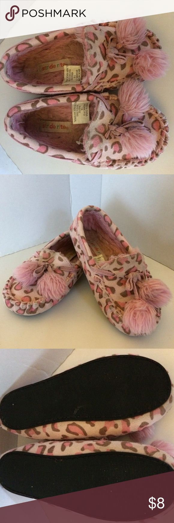 Toddler size 7 StrideRite pink slippers! Toddler size 7/8 StrideRite sturdy pink animal print slippers with Pom Poms and real non skid soles. Could even be worn as shoes! Machine wash. Loved so a little fading / discoloring. Stride Rite Shoes Slippers
