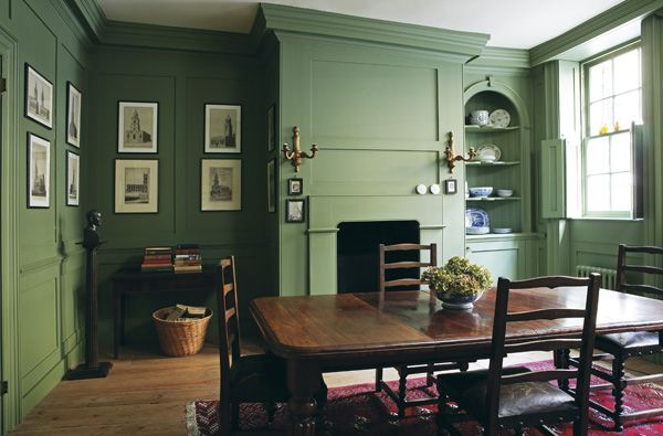 'Calke Green' by Farrow & Ball is another colour that pairs well with dark wood. As you can see, it looks warm and traditional when covering a whole room.  http://www.solidwoodkitchencabinets.co.uk/cabinets_blog/