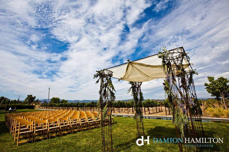 Rustic wine country wedding arch - Damion Hamilton