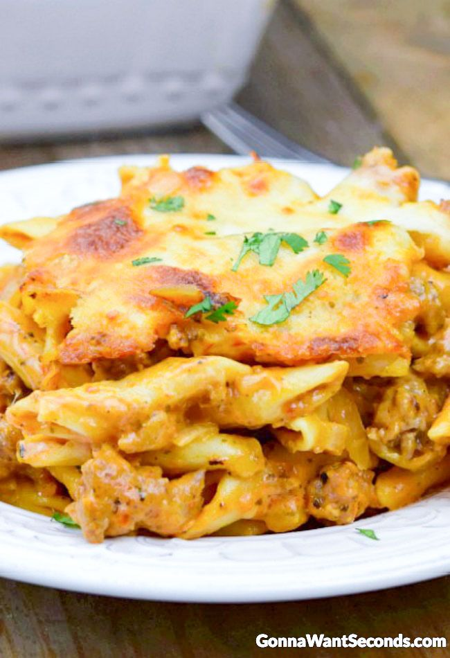 This easy Baked Mostaccioli is loaded with ooey gooey cheese and yummy Italian sausage all smoothered in a creamy tomato sauce.  Baked mostaccioli was a pretty regular feature on the dinner table when I was growing up. I think it was for a lot of people. That hearty, cheesy dish was a family favorite – …