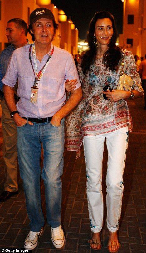 Enjoying the night air? Sir Paul McCartney and Nancy Shevell took a walk in the paddock following qualifying for the Abu Dhabi Formula One Grand Prix tonight