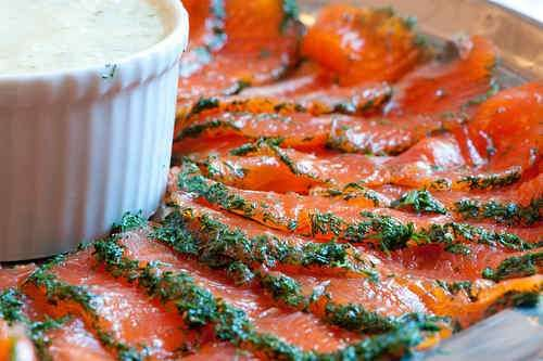 """Gravlax - The recipe is remarkably simple, and since then, I have made this dish many times. You just need a nice raw skin-on salmon fillet and a plastic container, ideally with a lock-on lid. After curing for a few days, it is best served with a special """"mustard-dill sauce for gravlax"""" and bread. Gravlax makes a wonderful starter but (with enough bread) it can also provide a full meal."""