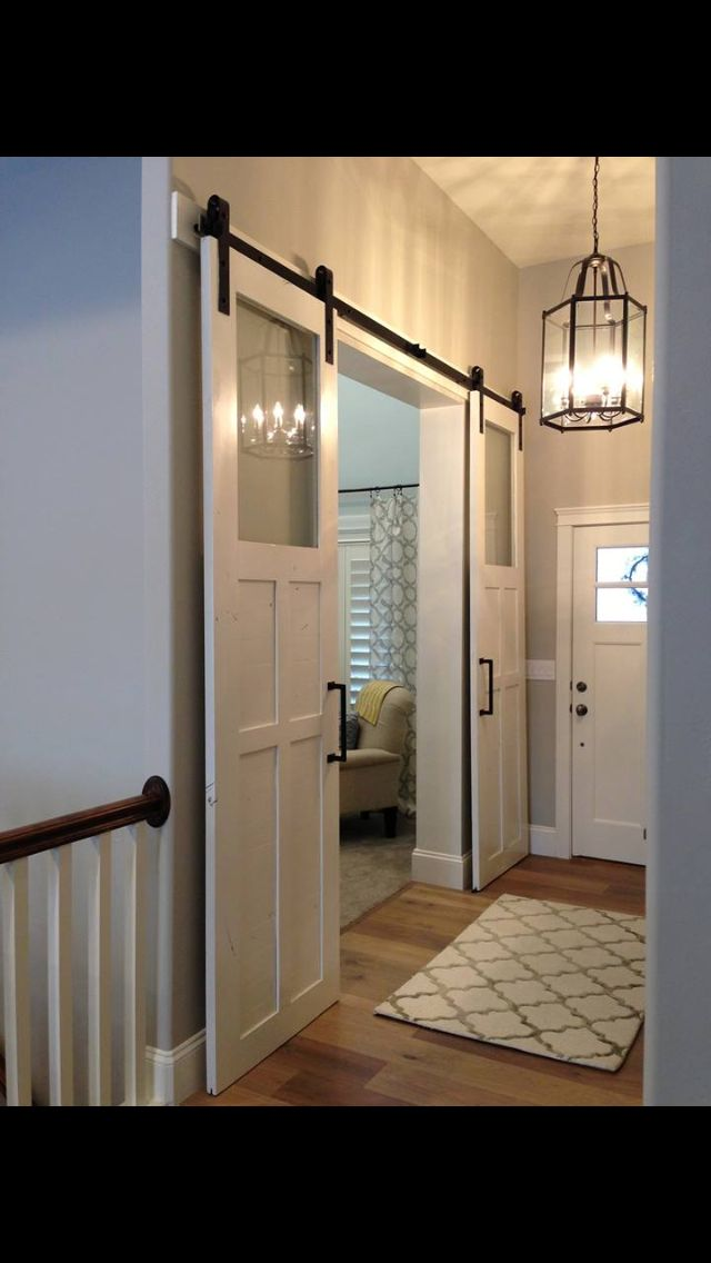 White doors. Vintage doors. Roller. Barn style for pool table room