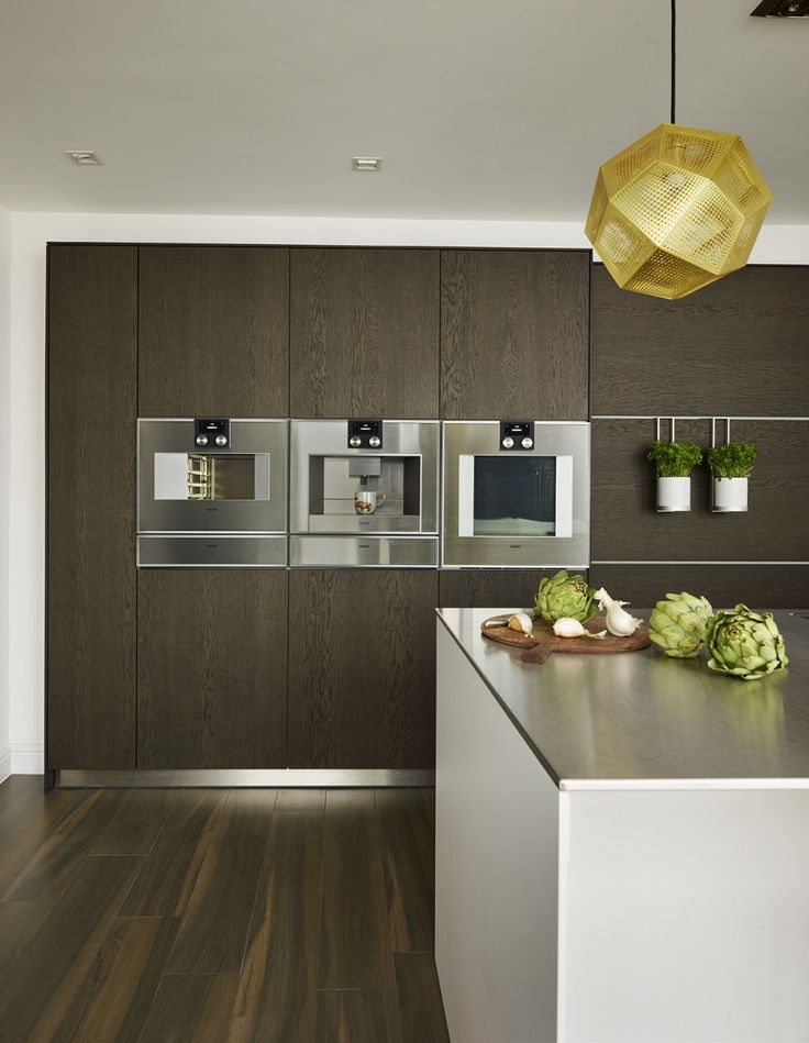 Bank of Gaggenau appliances in a bulthaup b3 kitchen. Appliances include Steam Oven, Conventional Oven, Coffee Machine and Warming Drawers. Sapphire Spaces | bulthaup Exeter - Gaggenau Appliances