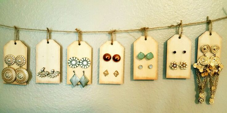 DIY stud earring holder, just poke holes in wooden tags with a nail and hammer and hang! So easy and so pretty!