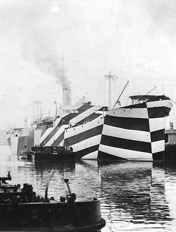 """Dazzle"" warship USS Mahomet in port, circa November 1918."