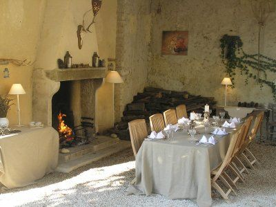 Autumn dinner in Provence...I want an indoor/outdoor fireplace!
