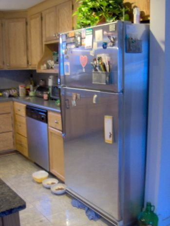 Stainless Steel Look Contact Paper Covers An Old Fridge