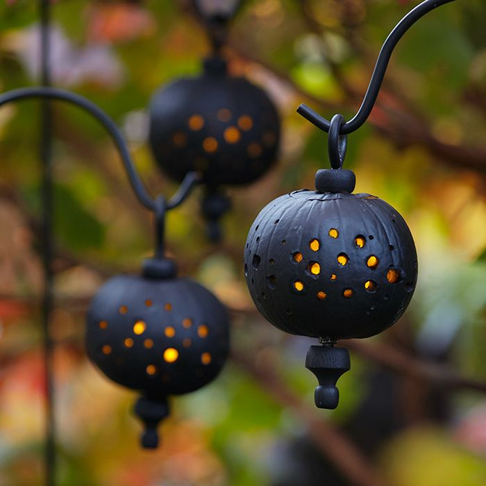 Light up an entry or walkway with DIY pumpkin lanterns. Use a drill to bore holes into painted pumpkins. Finials complete the lantern illusion. An access opening in back lets you load your lantern with LED tea lights. To hang, pass an eyebolt through the pumpkin and suspend from a shepherd's hook.