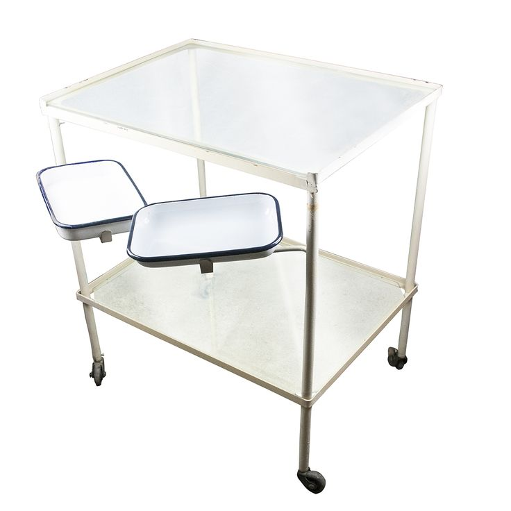 Metal hospital table with two enamel trays. It has one glass plate on top and one on the bottom. This model of table was used as a side table in operation rooms or during different manipulations in the communist time hospitals.