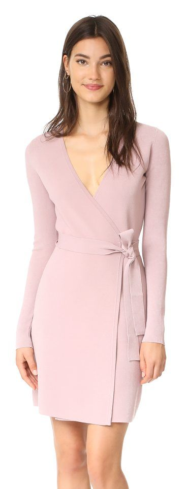 v neck knit wrap dress by Diane Von Furstenberg. Simple lines lend timeless elegance to this knit DVF wrap dress. Tie closure. Long sleeves. Unlined. Fabric: Crepe kn...