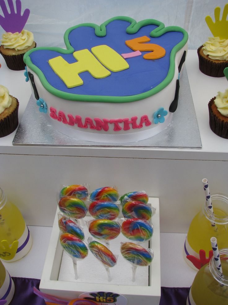 A Hi-5 themed birthday party is very popular with toddlers and preschoolers. This party was for a second birthday and featured brightly coloured treats, delicious cupcakes, fruit, jelly cups and giant rainbow lollipops! #lpl #partytheme #hi5 #birthday