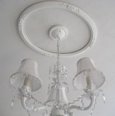 Make your own ceiling medallions using old picture frames, paint and screw to ceiling!!!  Genius!!!