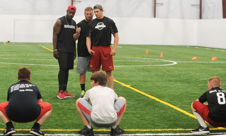 Former Iowa State football players Ernst Brun, Ben Durbin and Cory Morrissey work out local athletes at the Sports Iowa Indoor Turf Facility on June 29. Photo by Nirmalendu Majumdar/Ames Tribune  http://www.amestrib.com/sports/football-former-cyclones-start-athletic-training-business