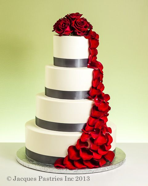 ivory and grey wedding cake with rose petal cascade