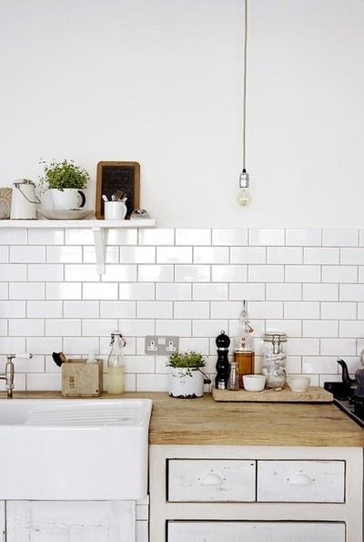 Farm style sink. Chopping block counter. And subway title back splash. 3 must haves for my kitchen ;)