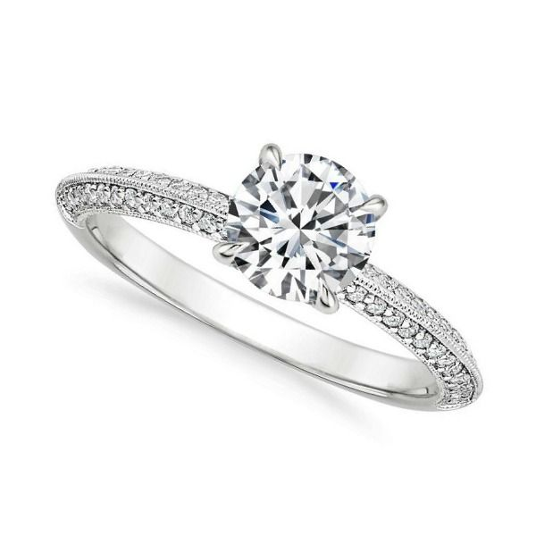 ''Destiny'' Amazing Knife-Edge Vintage Side Stone Diamond Ring This knife-edge engagement ring dazzles with a thin band of milgrain dividing two rows of sparkling pavé set diamonds extending halfway down the band. Claw prongs embrace the center diamond for an elegant look.