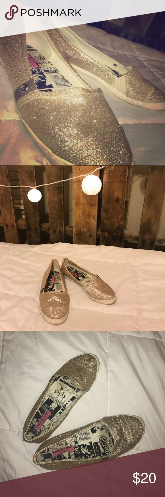 Cute gold sparkly shoes!! These are super sparkly gold rock and candy by Gigi converse and they are in good condition! Up for offers:) rock & candy by gigi Shoes Sneakers