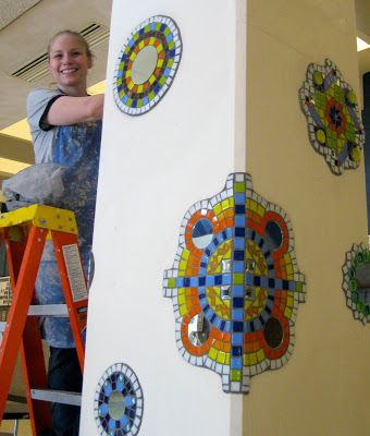 Mosaic Medallions Project by Judy Sells in an elementary school decorate the pillars in the school's cafeteria
