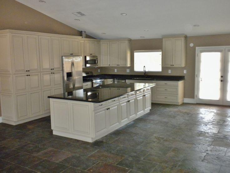 Cottage white cabinets with chocolate glaze and black for White kitchen cabinets with chocolate glaze