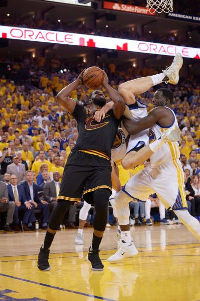 NBA Finals Cleveland Cavaliers Tristan Thompson in action vs Golden State Warriors Klay Thompson and Draymond Green at Oracle Arena Game 5 Oakland CA...