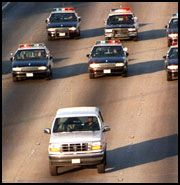 The infamous low speed chase of OJ Simpson's white Ford Bronco 5 days after the murder of his ex wife and her boyfriend.  He surrenders and is charged with their murders.  June 17, 1994