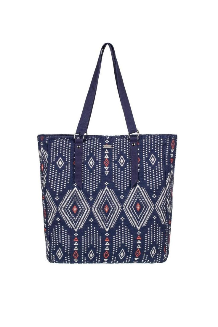 """Geometric printed fabric bag with zipper closure and metal plaque. Navy base with white and poppy read print.    Size: 15.75""""[H] x 14.25""""[W] x 5.25"""" [D] / 40[H] x 36 [W] x 13 [D] cm.   Boho Party Tote by Roxy. Bags - Totes Thousand Islands, Canada"""