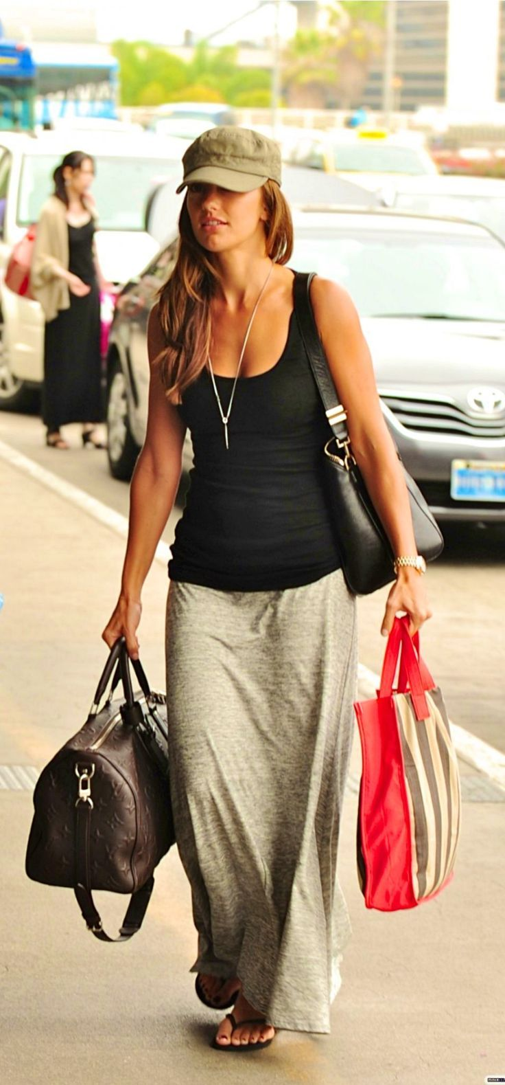 Minka Kelly gettings casual in a fitted tank and maxi skirt! Get your look like this at RPBoutique.com