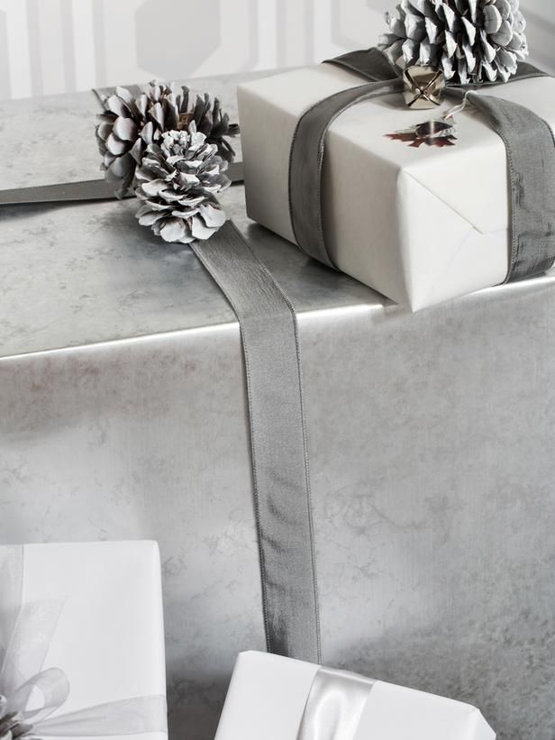 Keep the Look Cohesive - 10 Tips for Creating an Elegant, All-White Christmas Tree on HGTV. Keep the Look Cohesive Once the tree is decorated, choose wrapping papers, ribbons and bows in different shades of white to carry the tree's look down to its coordinated gifts. Here, a combination of white, gray and silver wrapping paper and metallic ribbon are used to keep the gifts cohesively layered.