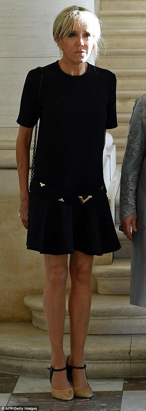 French First Lady Brigitte Macron donned the same Louis Vuitton frock she wore visit Magritte Museum in Brussels earlier in the day. However, Melania slipped out of her leather suit and changed into a lace dress before reuniting with the group