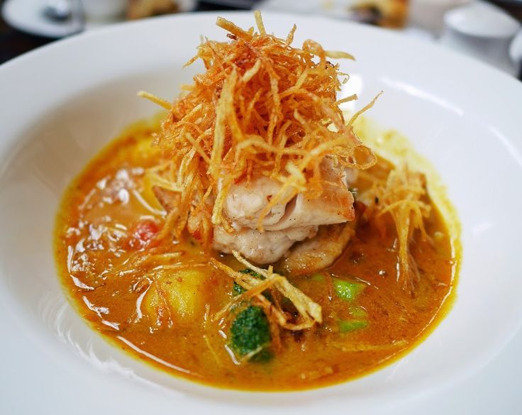 Ikan Kuah Kemangi, Our signature dish at Kemangi Bistro, a delightful dish combination with Baked baby snapper and fresh yellow kemangi curry
